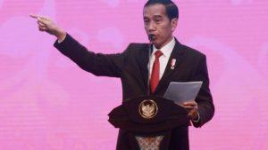 Presiden Joko Widodo setidaknya dalam dua kali kesempatan menggunakan istilah 'gebuk' untuk PKI. [AFP]