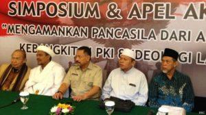 Rizieq Shihab dan Letjen (Purn) Kiki Syahnakri menjadi pembicara pada simposium 'anti-PKI'. [BBC INDONESIA]